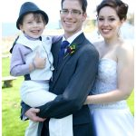 Bride and groom with son at their ceremony