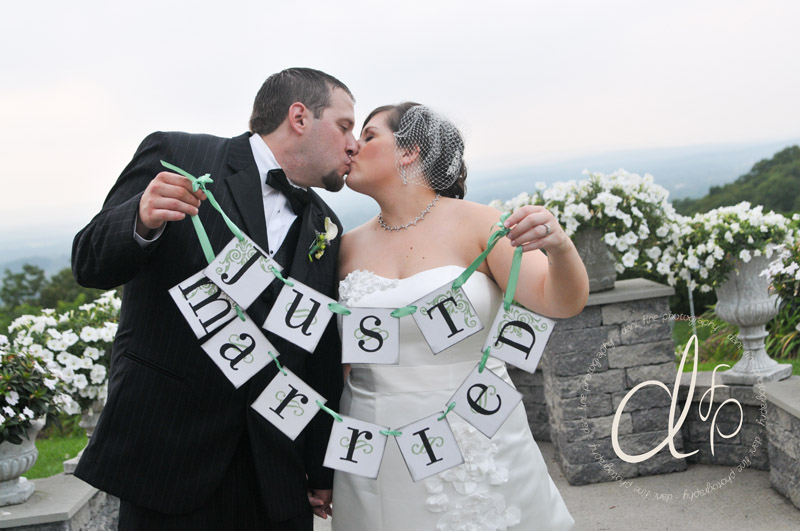 Bride and groom with Just Married sign