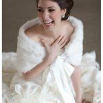beautiful bride laughing while wearing a fur wrap