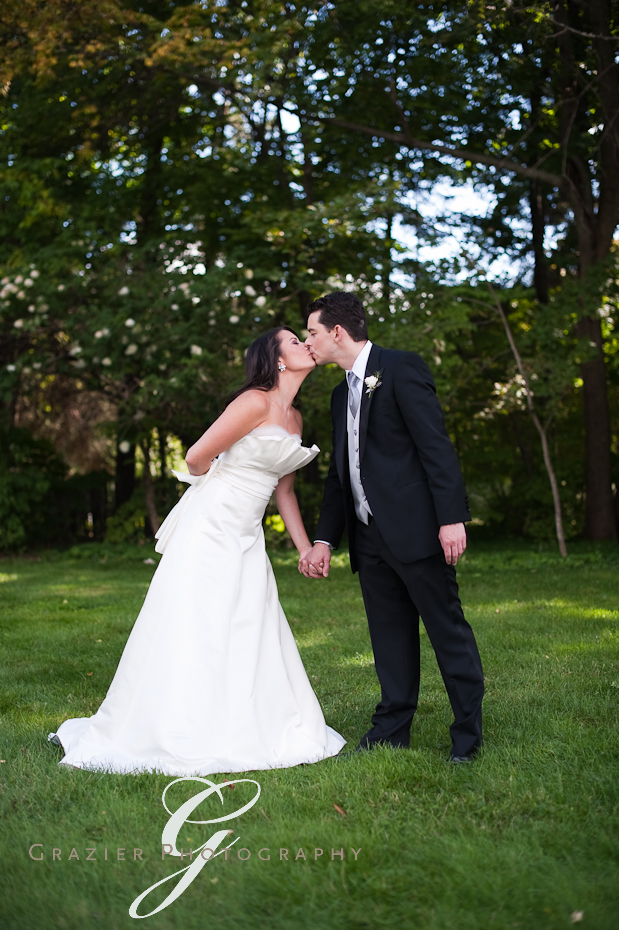 bride and groom kiss at the Winthrop Estate Lenox MA