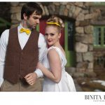 Bride with cateye liner and red lips posing with groom at Willowdale Estate