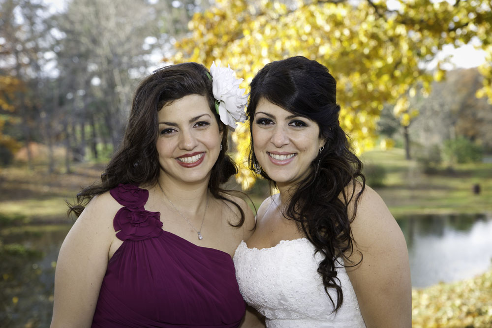 bride and her sister with retro glam makeup