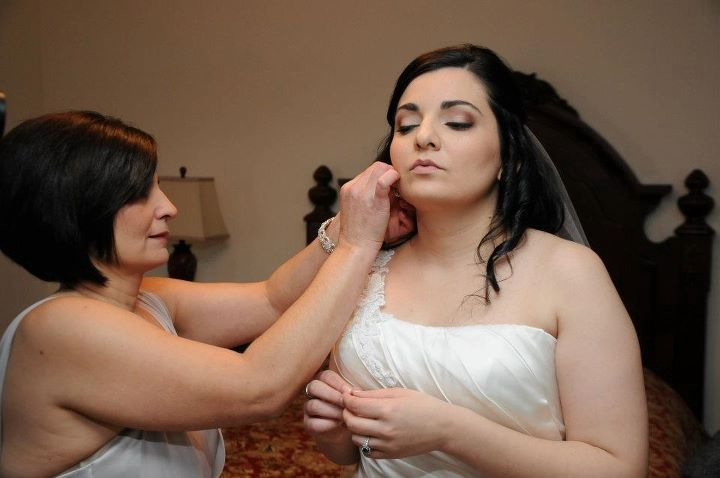 Bride's mom putting in her daughter's earrings