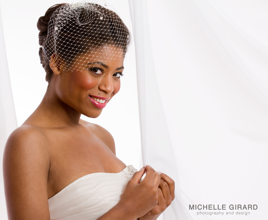 AfroAm bride with gold eyeshadow and birdcage veil