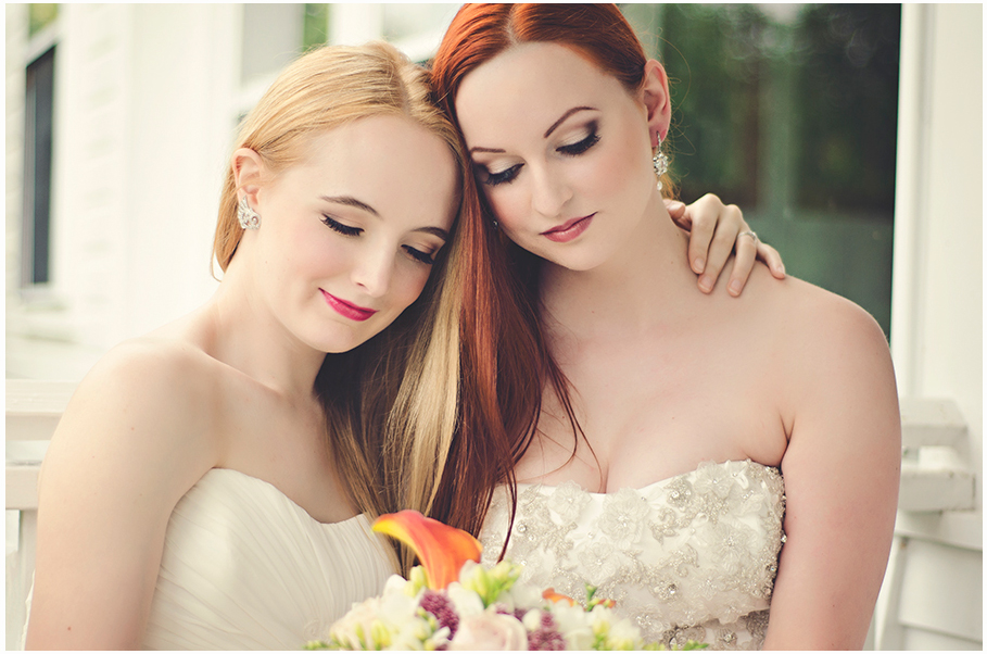 Two brides with beautiful glamorous makeup embracing