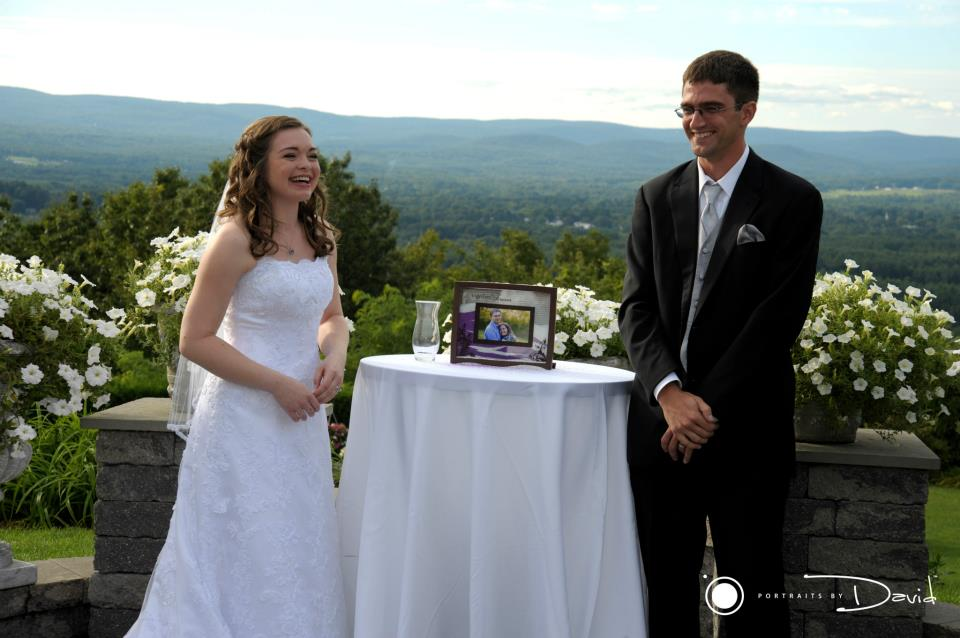 bride and groom laughing during ceremony at the Log Cabin in Holyoke MA