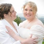 smiling brides at their wedding in western ma