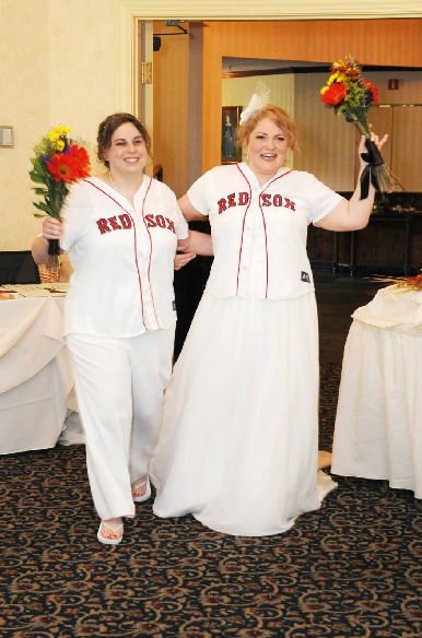 brides enter reception wearing matching Red Sox jerseys