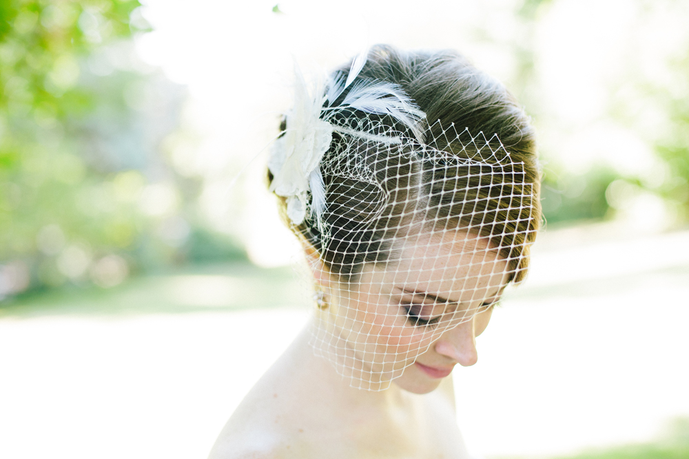 bride with smoky eyes and birdcage veil