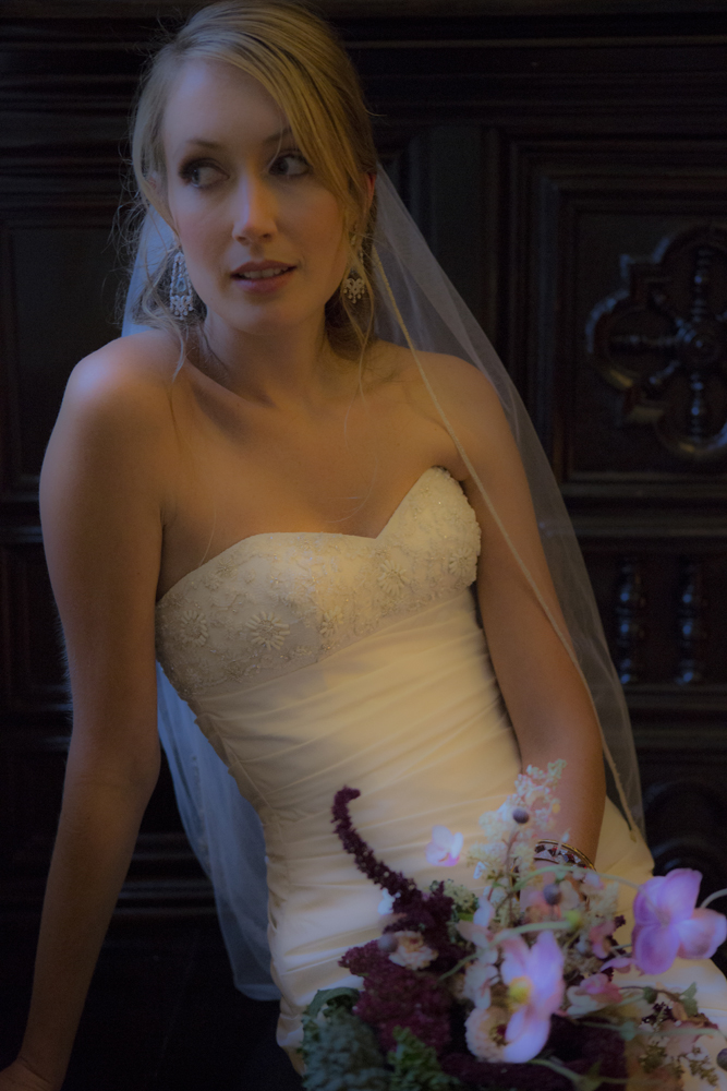 Beautiful bride with smoky earthtone eyes posing at the Seven Hills Inn in Lenox MA