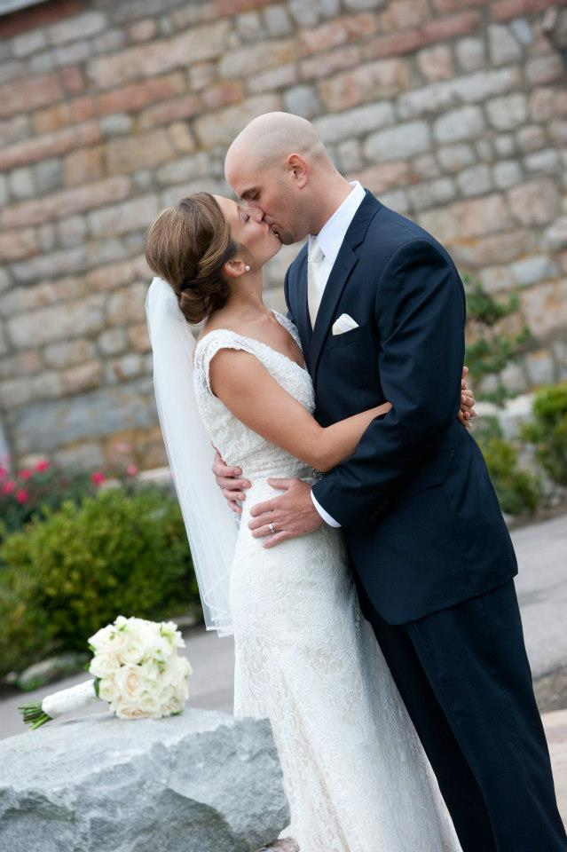 Bride and Groom kiss at the Coast Guard House in Narragansett RI
