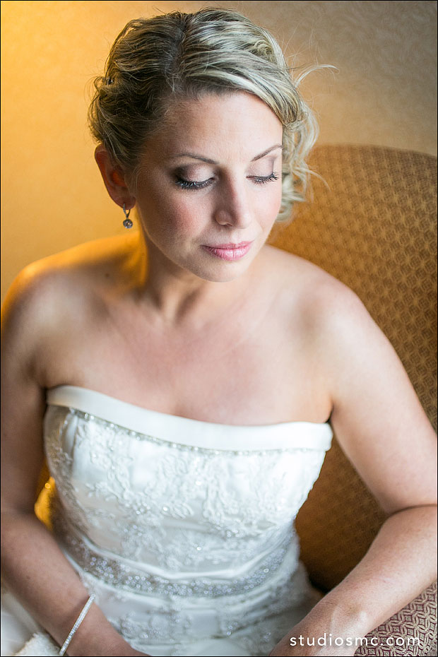 Elegant bride showing off her smoky eyes