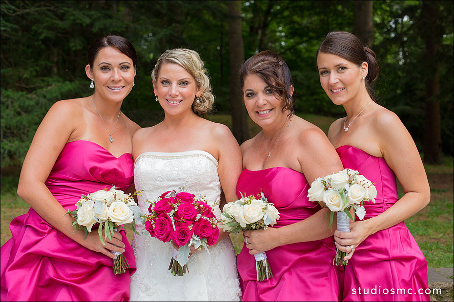 Bride and her maids in fuchsia pink